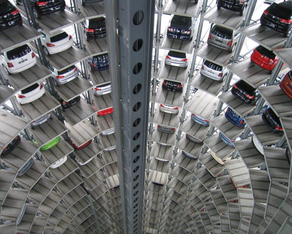 A car parking lobby with multiple floors and cars