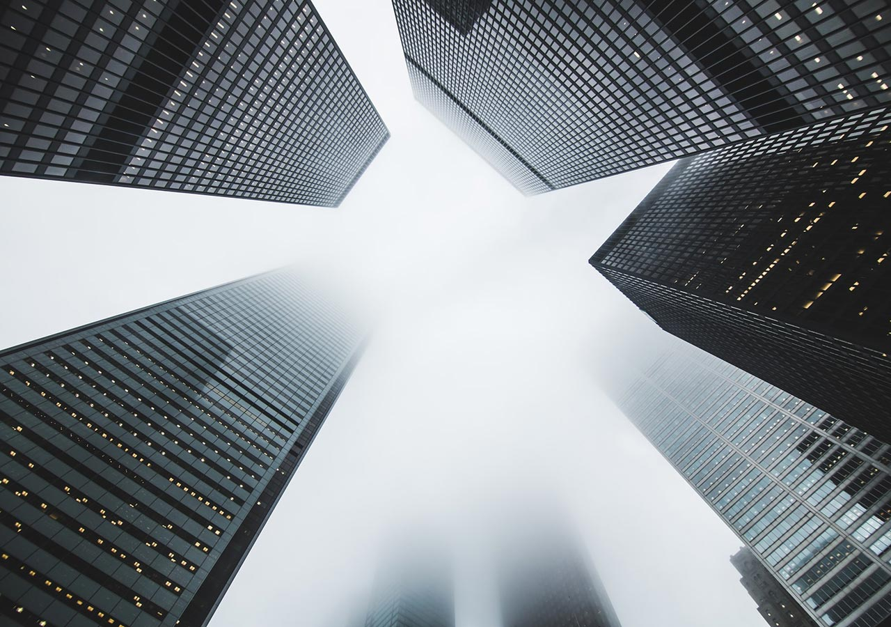 Tall financial buildings adjacent to each other. Financial Services is another sector Idiro works with