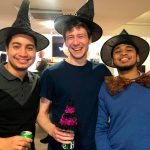3 Data analyst's of Idiro Analytics wearing black hats and posing for a picture on Halloween
