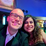 Idiro Analytics client's director, SImon Rees and Marketing Strategist Devina Menon smiling in a selfie