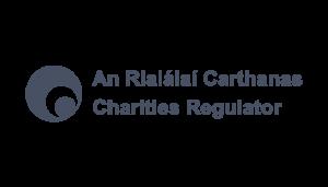 Charities Regulator logo on a checkered background on Idiro website. Client testimonial