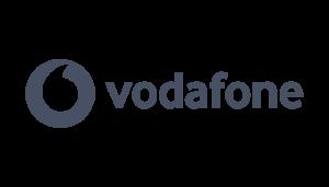 Vodafone logo on a checkered background on Idiro website. Client testimonial