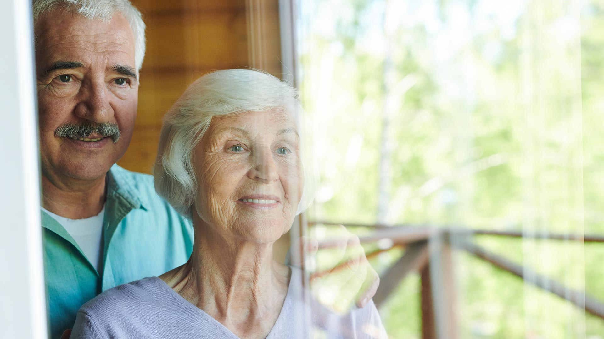 An old couple looking outside the window. Idiro's case study on Pensions Authority
